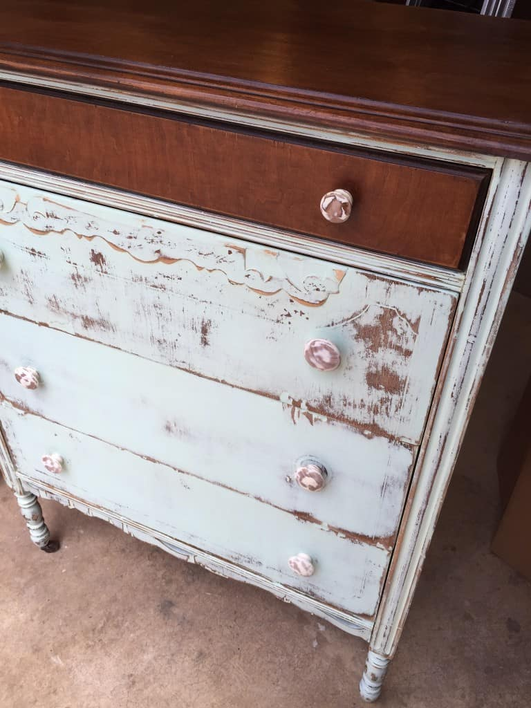 front of dresser with handles changed to solid wood painted white and heavily distressed as well.
