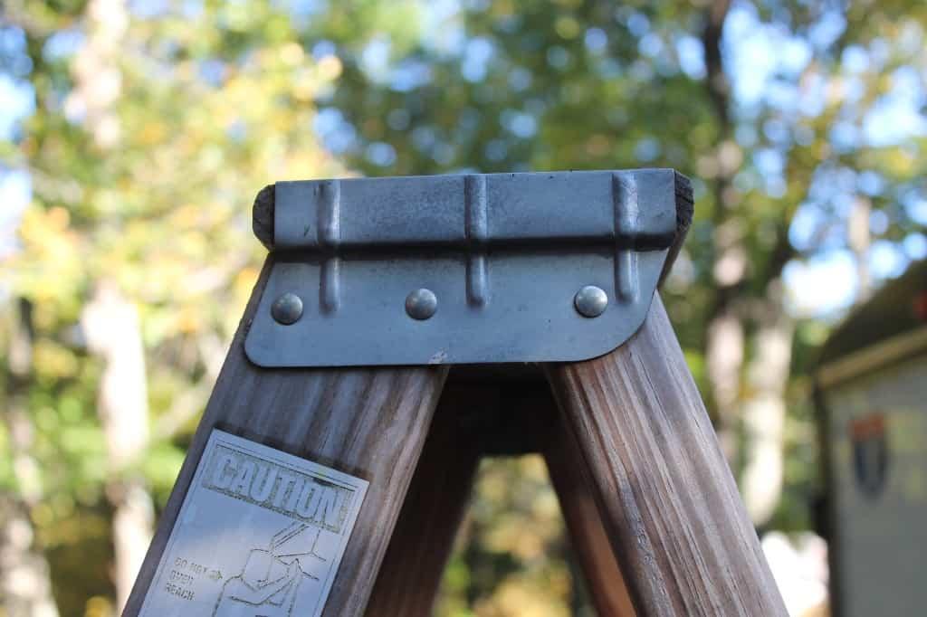 top rung of a wooden ladder