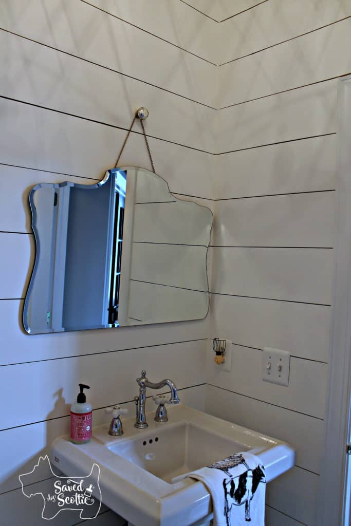 finished bathroom by saved by scottie with shiplap walls and new mirror and sink area
