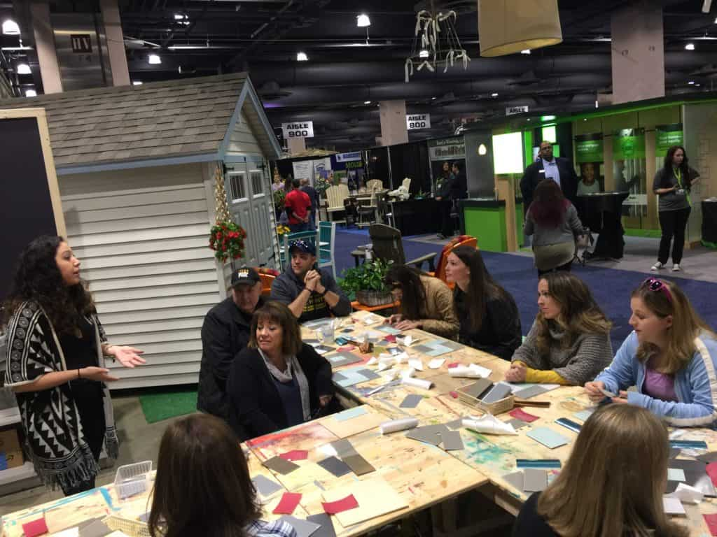 Make it Take It workshop being taught by Evey and Scottie showing attendees of the 2017 Philly Home Show how to make a tile trivet with Aspect tiles