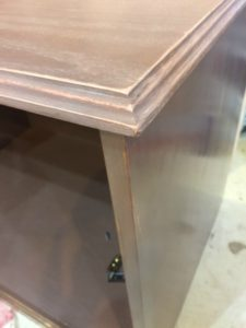 routed edge of painted credenza