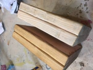 wood supports for Scotties headboard. one is stained and one is not