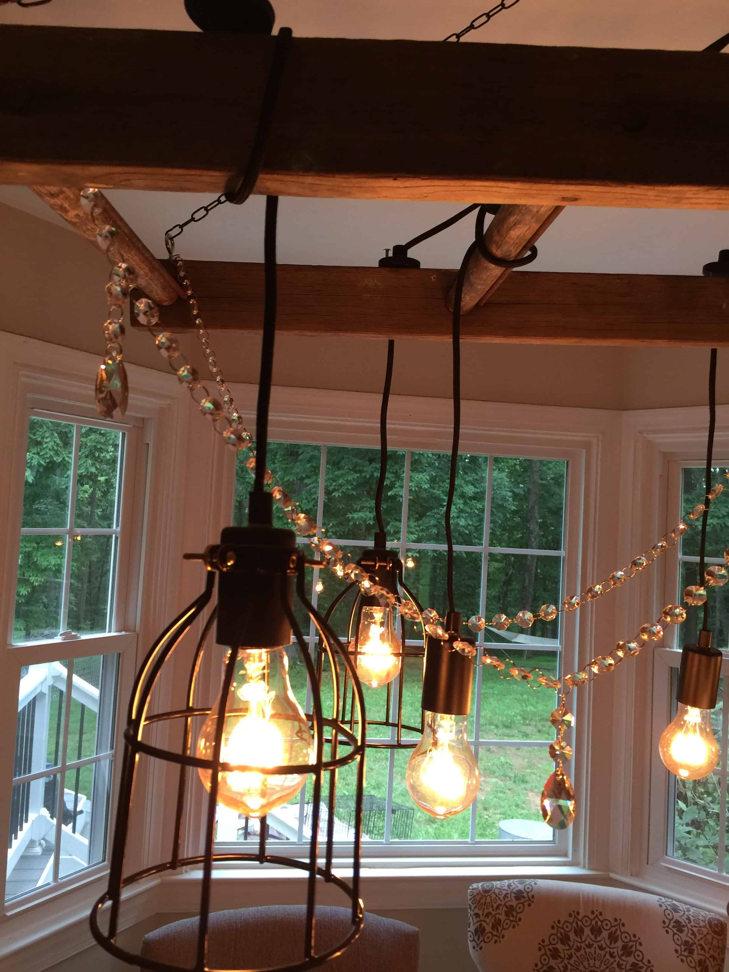Saved by Scottie rustic chandelier adding crystals