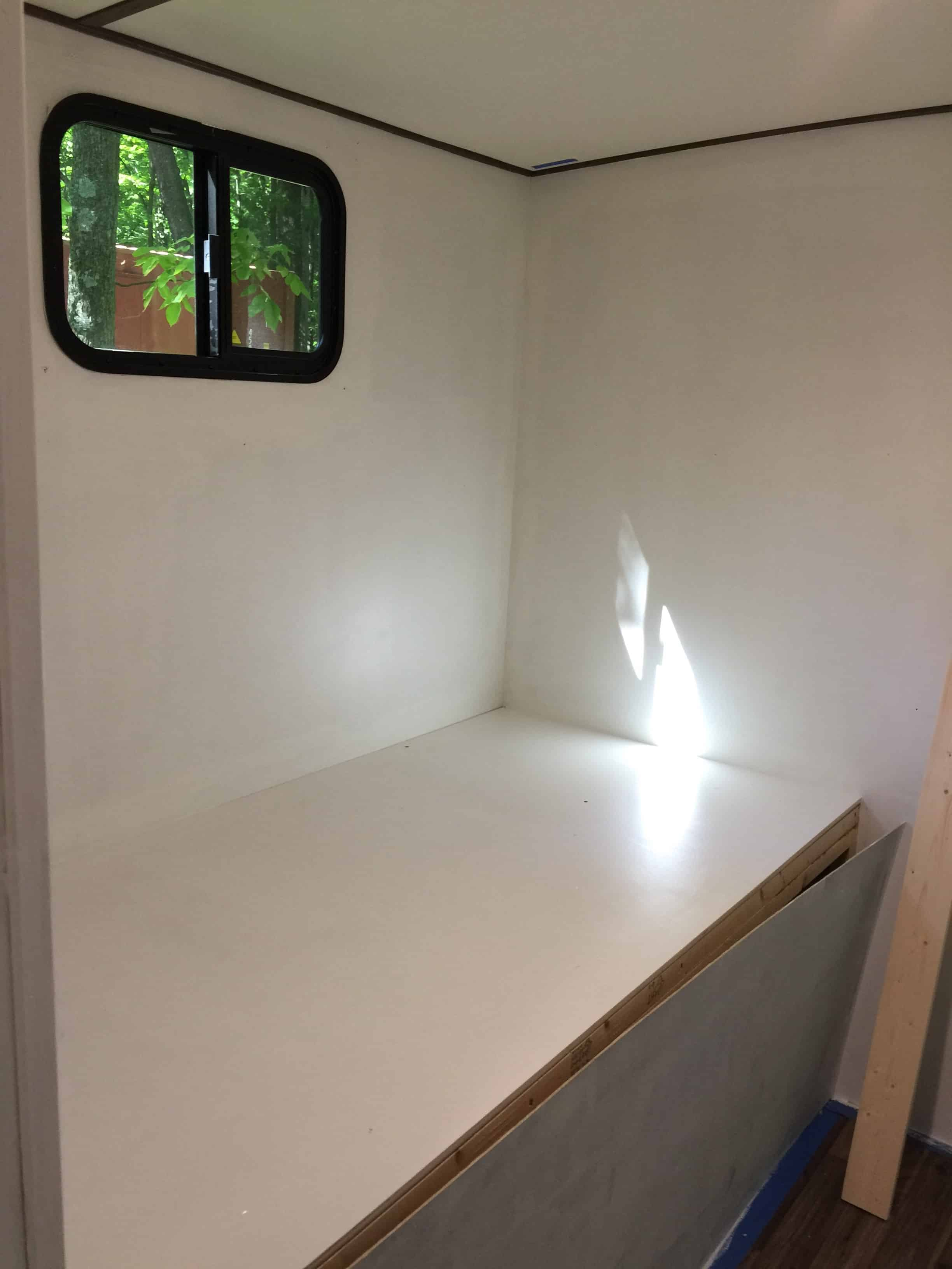 rv remodel cabinet build clean slate open bunk area painted white ready for cabinets