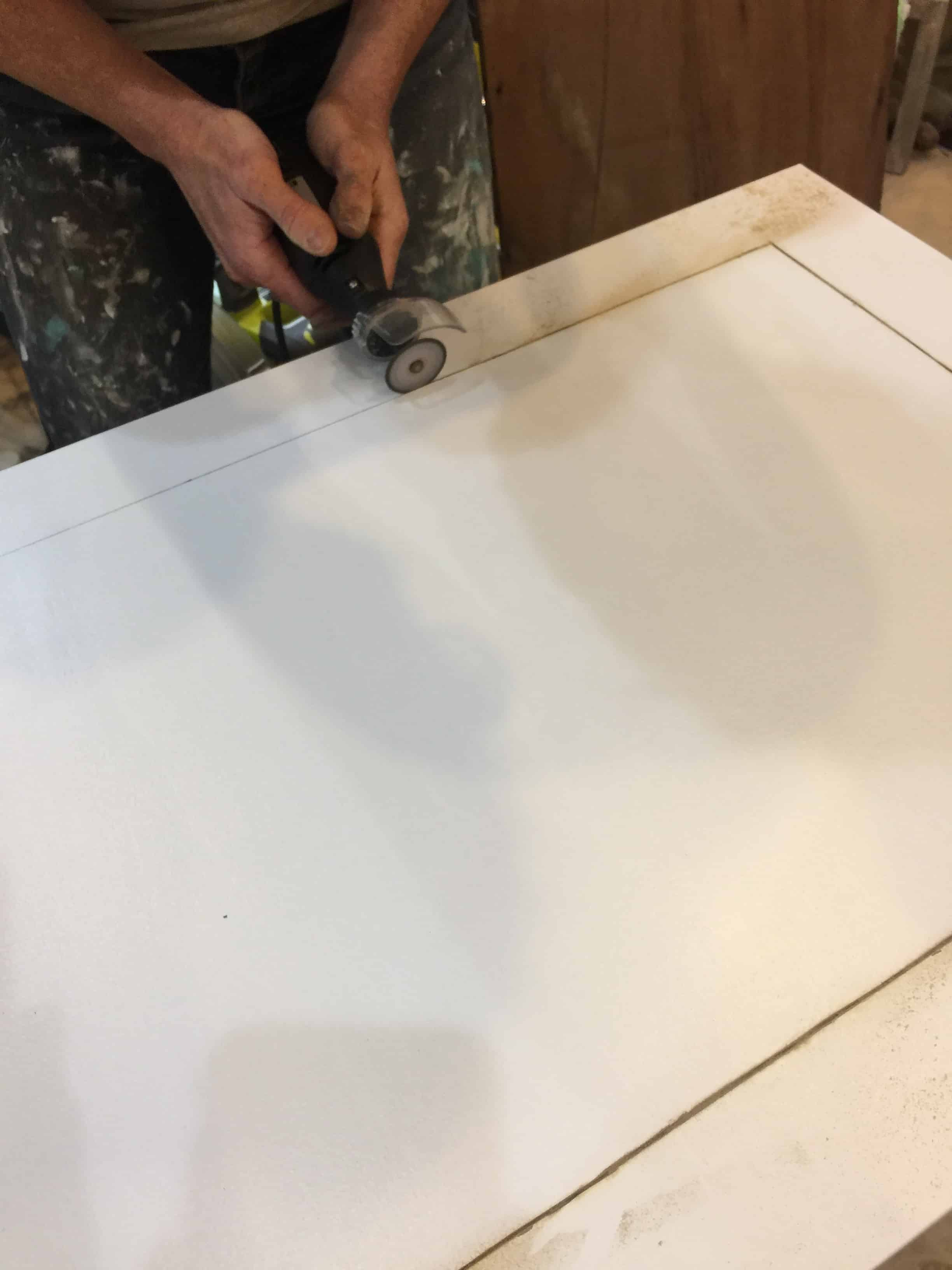 Saved by Scottie rv remodel door build cutting window with Dremel close up