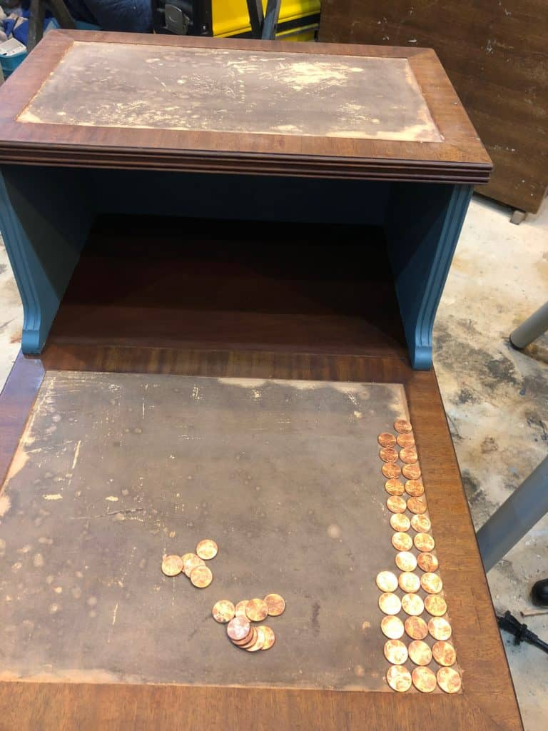 initial layout of the pennies in the open areas of the table top