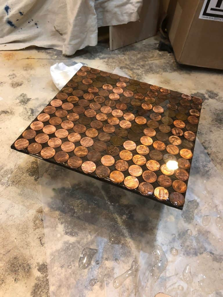 test tile of pennies with epoxy poured over them.