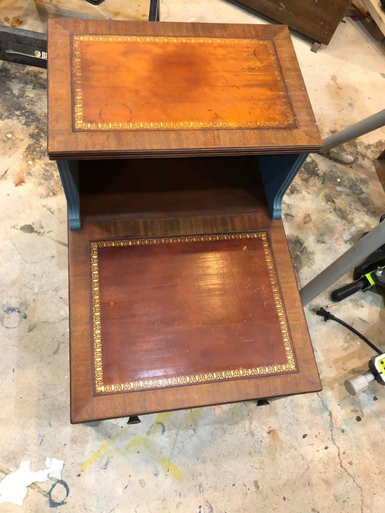 a picture of the table top leather pieces after being stained with Shabby Paints reVax