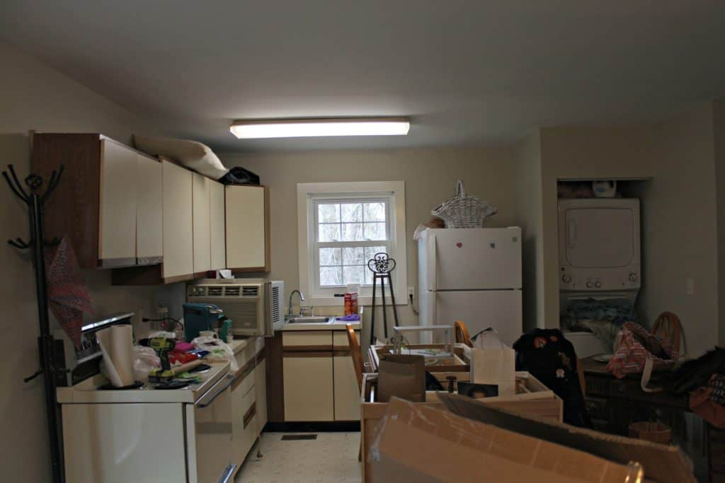 messy dated kitchen in small apartment