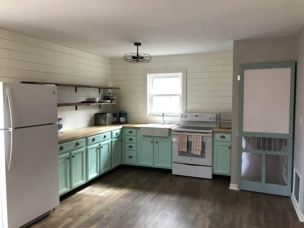 updated farmhouse kitchen with installed shelves alt view