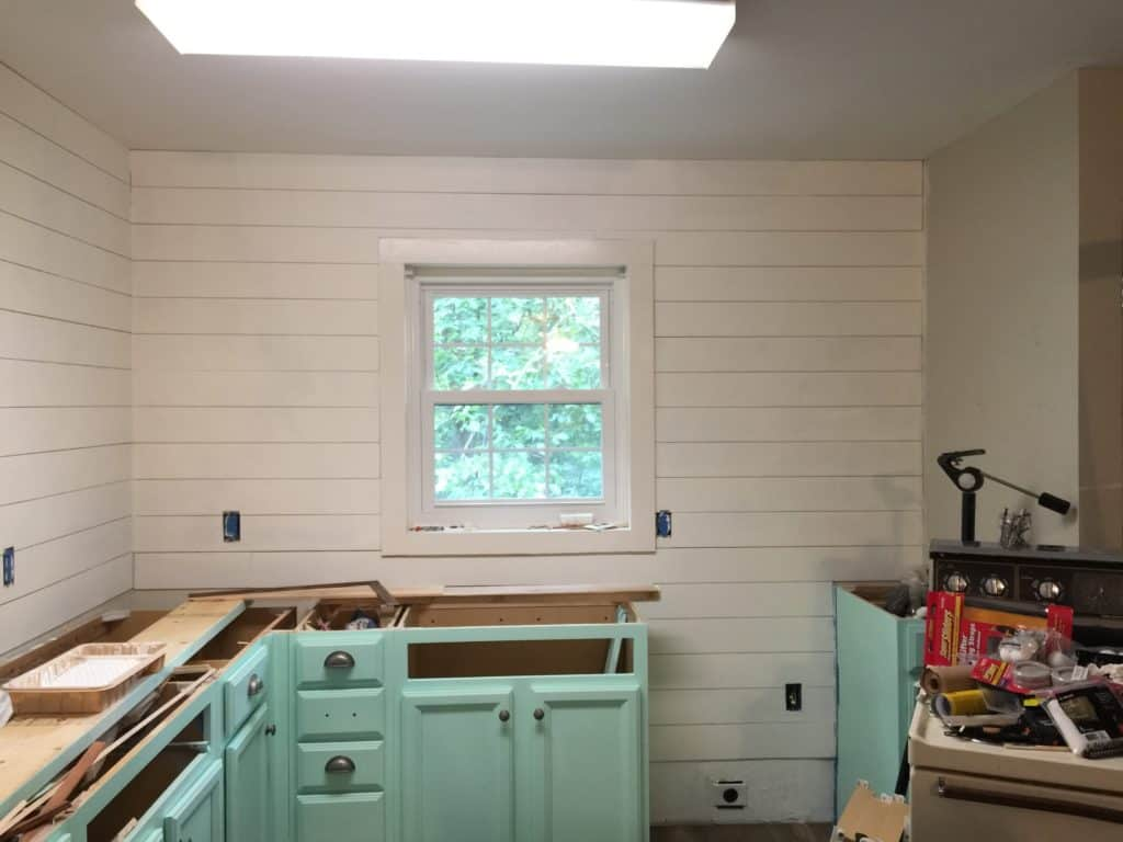 painting of the faux shiplap in the kitchen update process