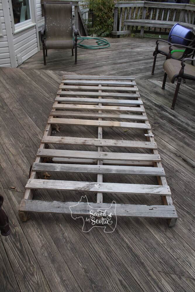 a wood pallet with a few missing slats laying on a wood deck