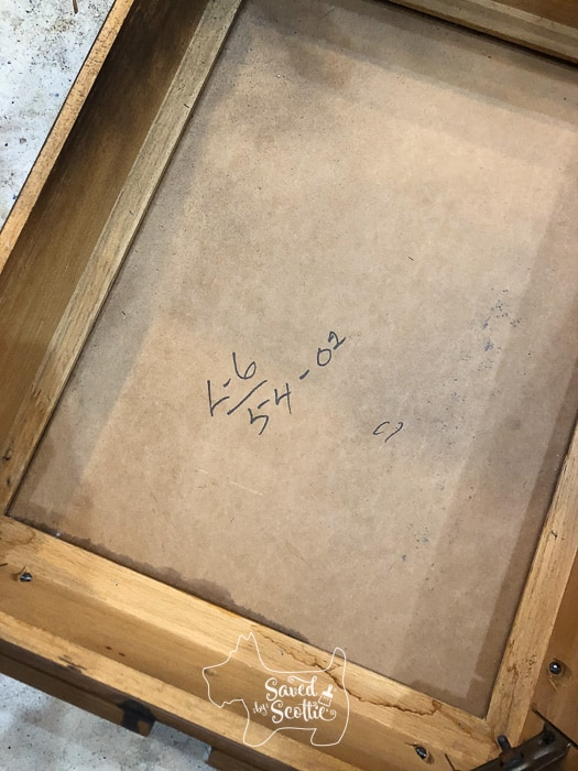 underside of table. handwritten markings L-6 and 54-02 that don't seem to mean anything