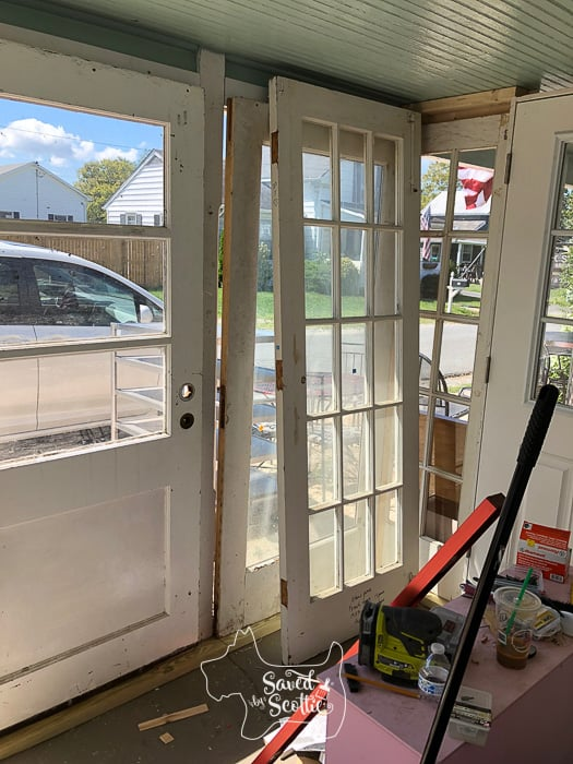 old doors being laid out and installed on the porch