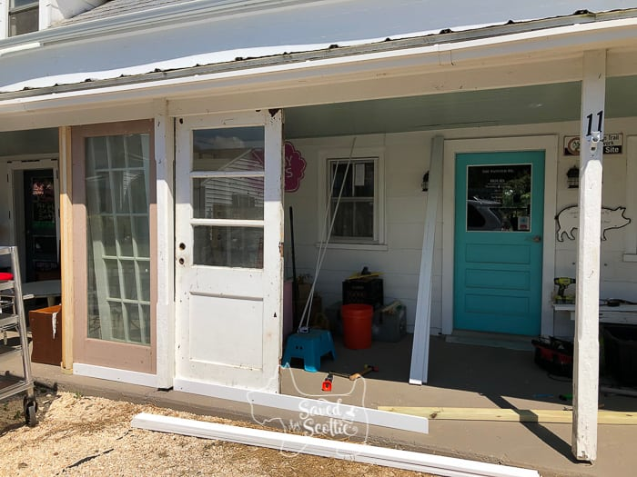 vintage doors being placed and secured for a diy sunroom