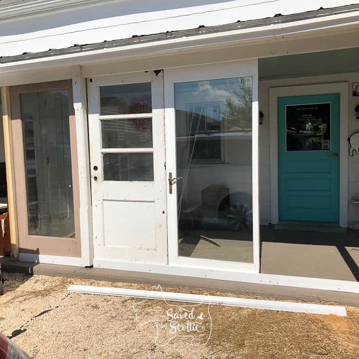 vintage doors being placed to create a DIY sunroom.