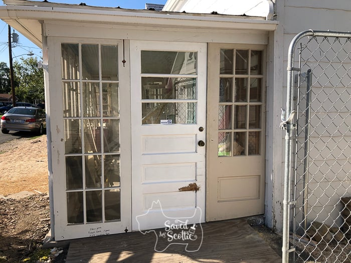 a side view of the entry doors to the DIY sunroom before being painted and trimmed out