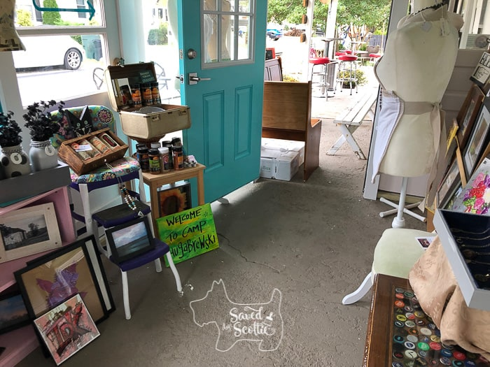 front porch of retail shop with various artisan goods for sale.