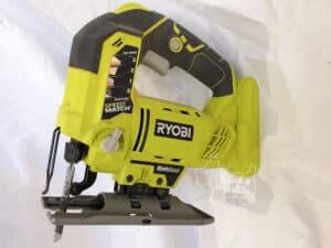 ryobi battery powered jig saw with white background