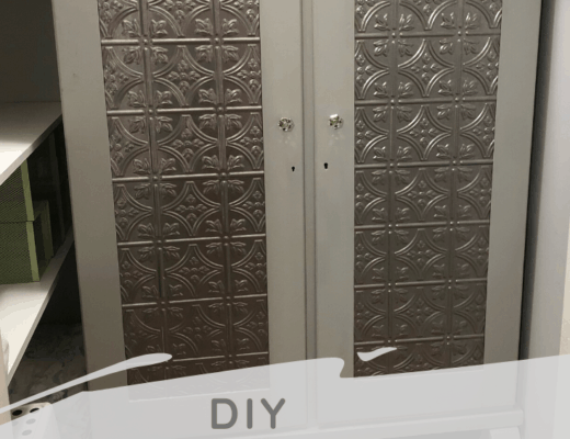 diy armoire makeover finished product picture gray trim and metallic silver inset fasäde decorative panel on the front