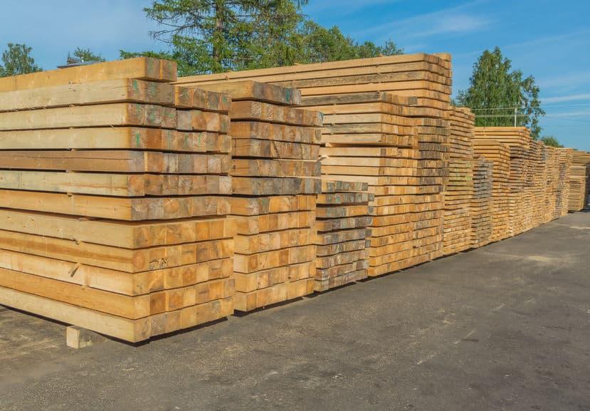 stacks of lumber at an outdoor lumber yard