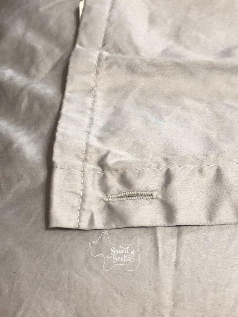 button hole on grey Therapedic flat sheet