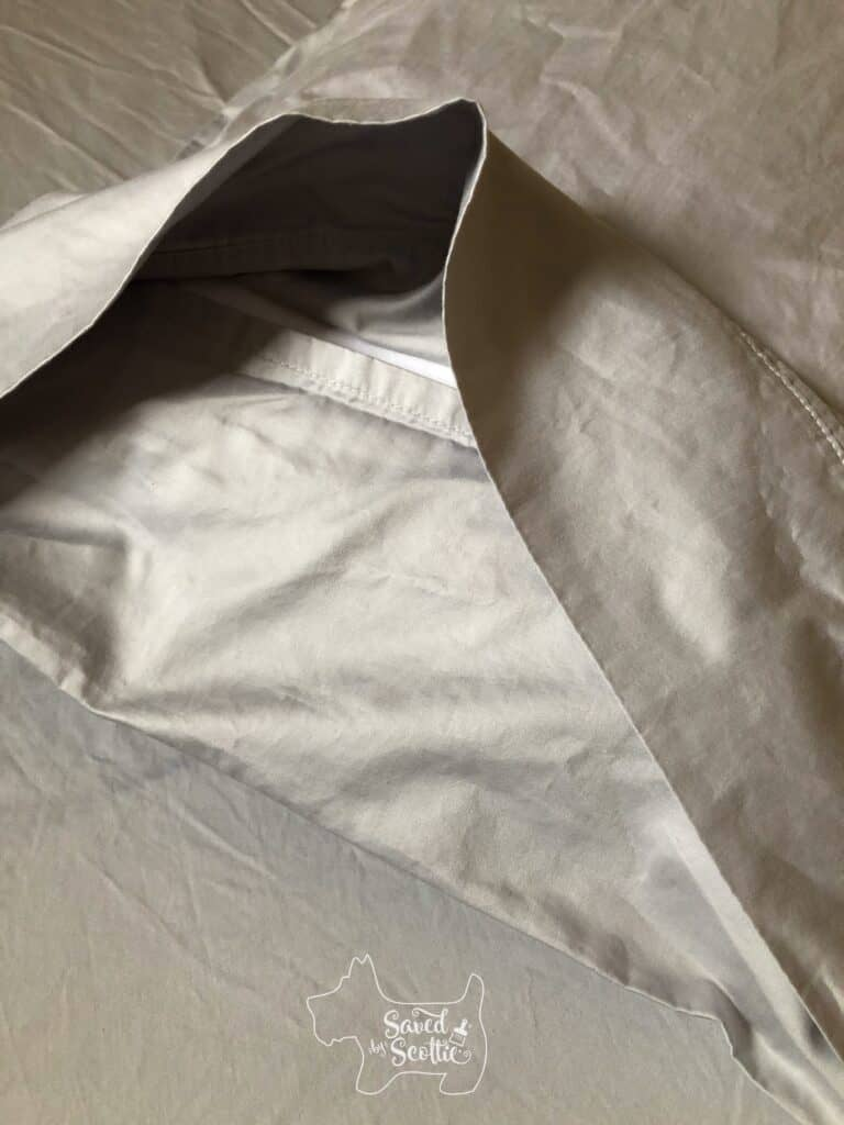 inside of grey Therapedic sheets pillowcase with flap closure.