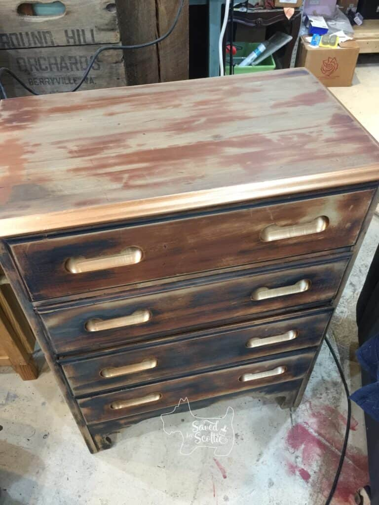 picture of dresser from the top tangle o show the entire piece and the copper painted touches are shining and showing up as metallic.