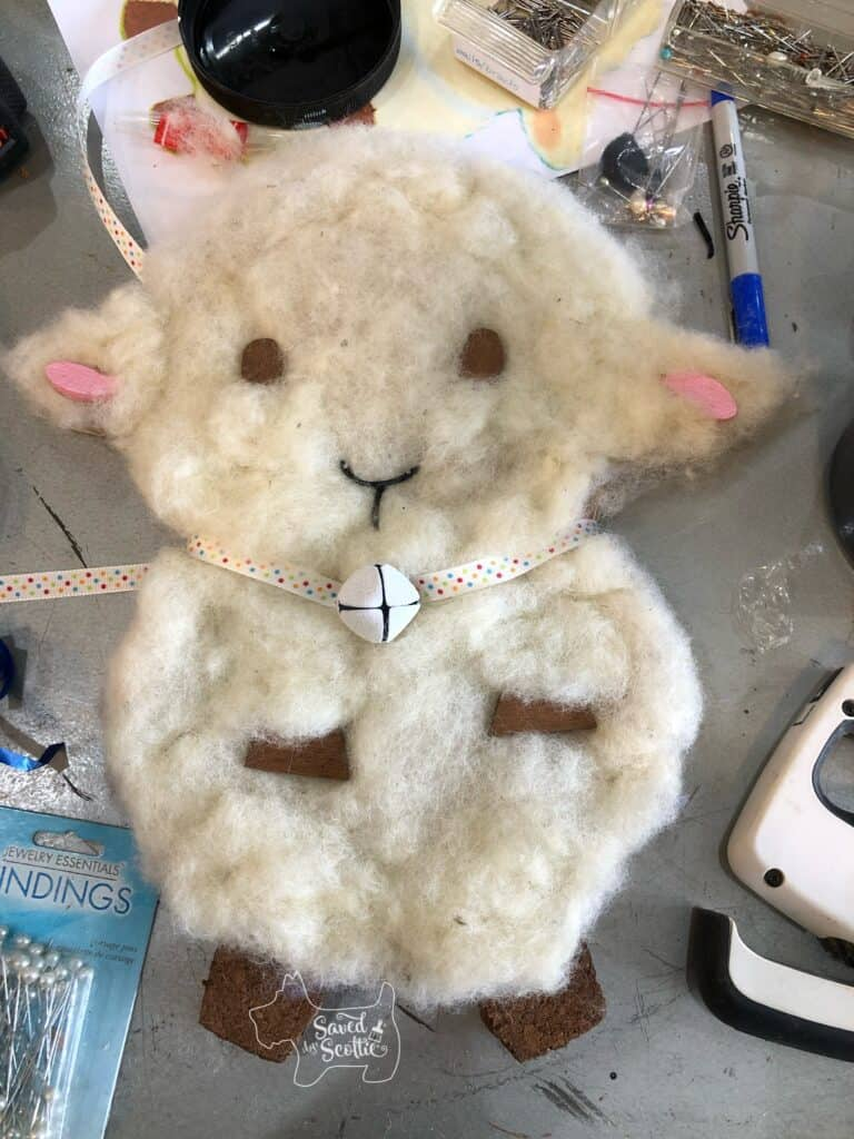 image of finished BFF gift of a cork board that looks like a sweet sheep with a bell and ribbon collar.