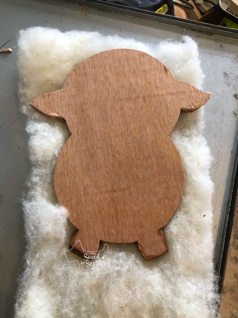 cut silhouette image laying on layer of wool to create the BFF gift