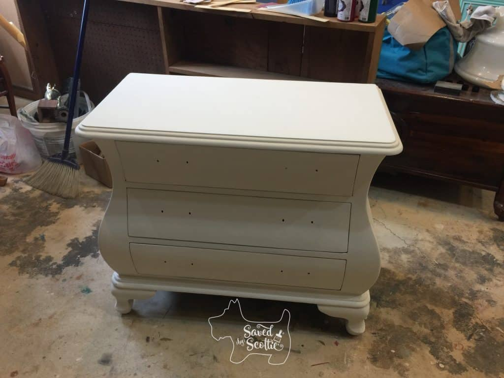 solid white painted bombay chest in workshop environment. No handles or hardware attached.