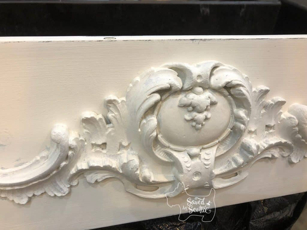 close up of white moulding on bombay chest drawer
