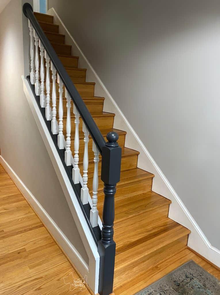 edited picture with unpainted handrail on the back wall removed. Grey paint on wall, white trim and balusters and off-black railings.