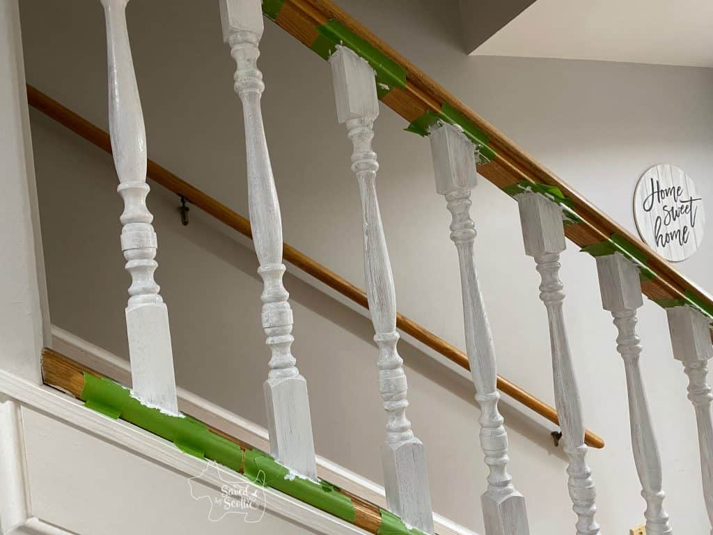 first coat of white paint on the balusters of the painted stair railings