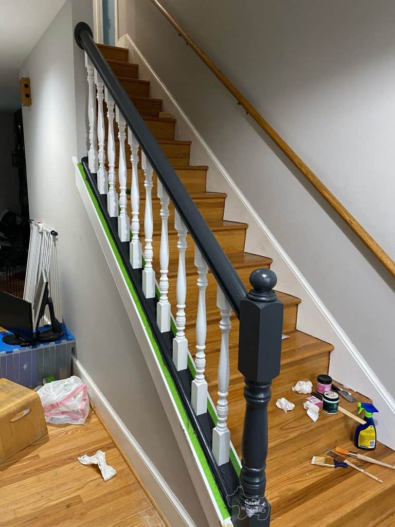 finished painted stair railings before tape removal and with off-black Cracked Pepper paint. Grey walls and clutter in hallway to block visits from the current house goats.