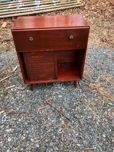 mid century cabinet in need of repair. Missing one sliding door