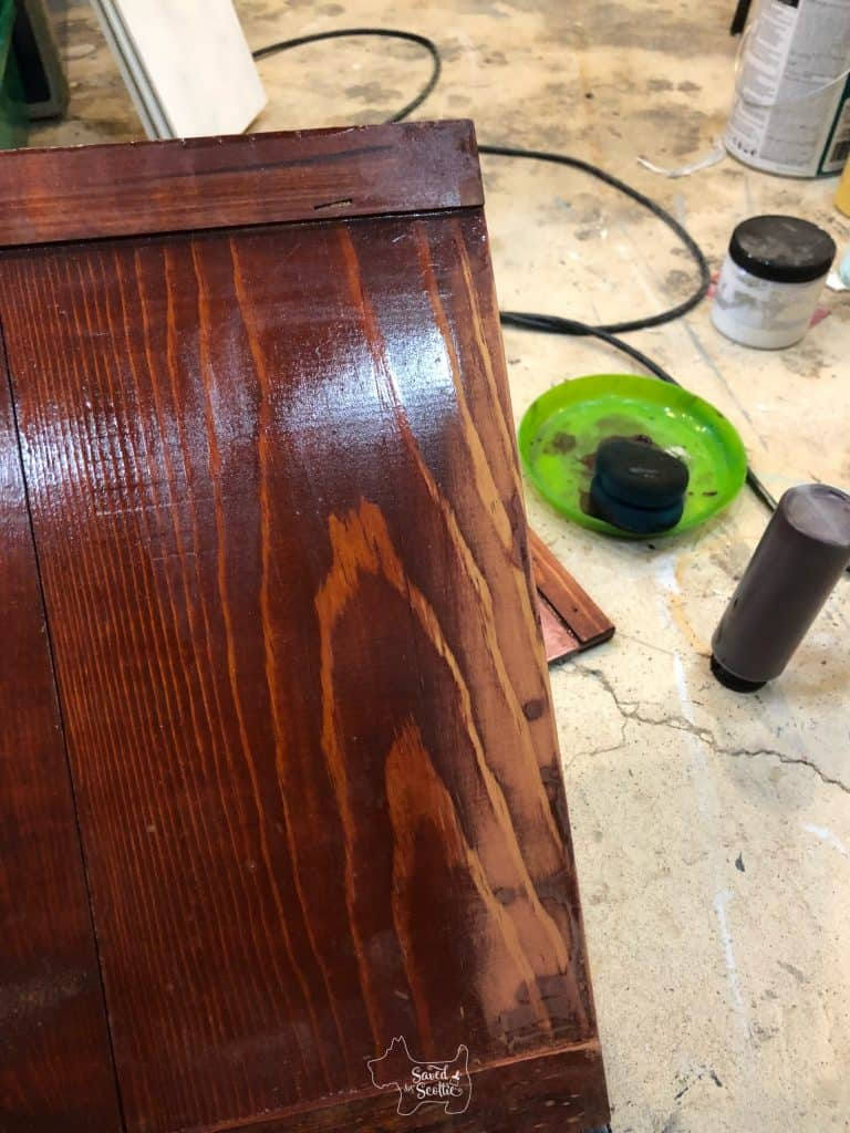 bottom of cabinet door after sanding away clumps of polyurethane causing it to stick in the track