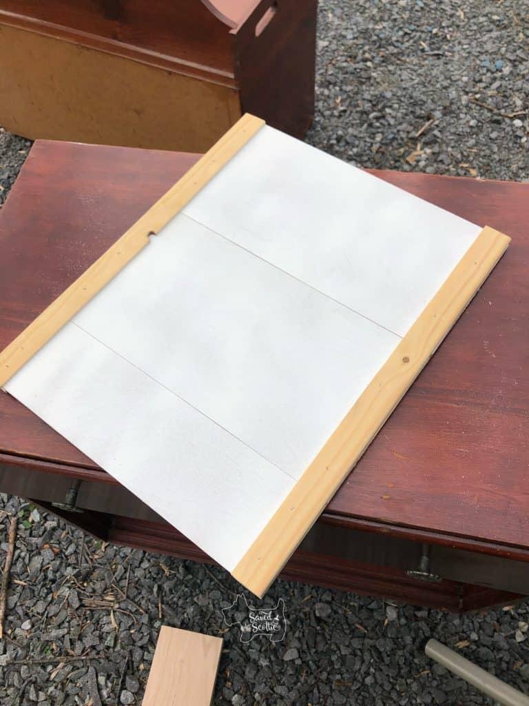 """""""new"""" door made from leftover scraps of 1/4 plywood shiplap and 1x2s on each end routed to hold the wood pieces."""