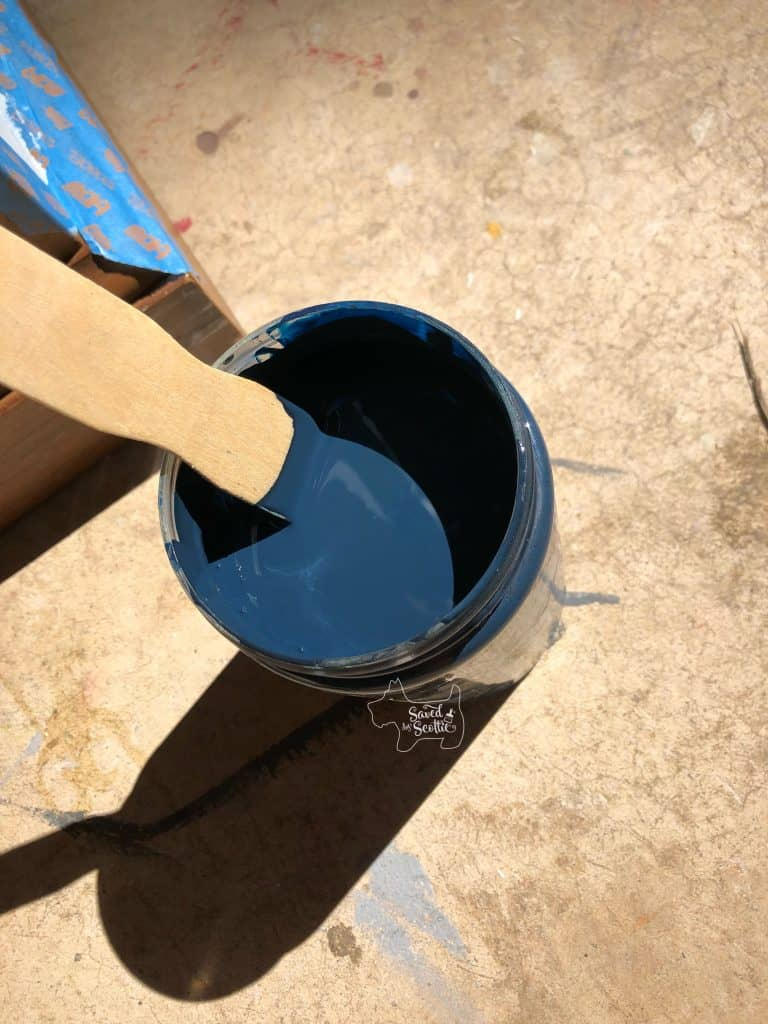 mixed paint colors in a new container showing a deep black-toned navy color.