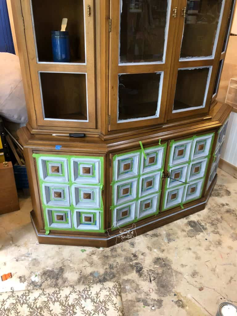 view of china cabinet in painting process with primer added.