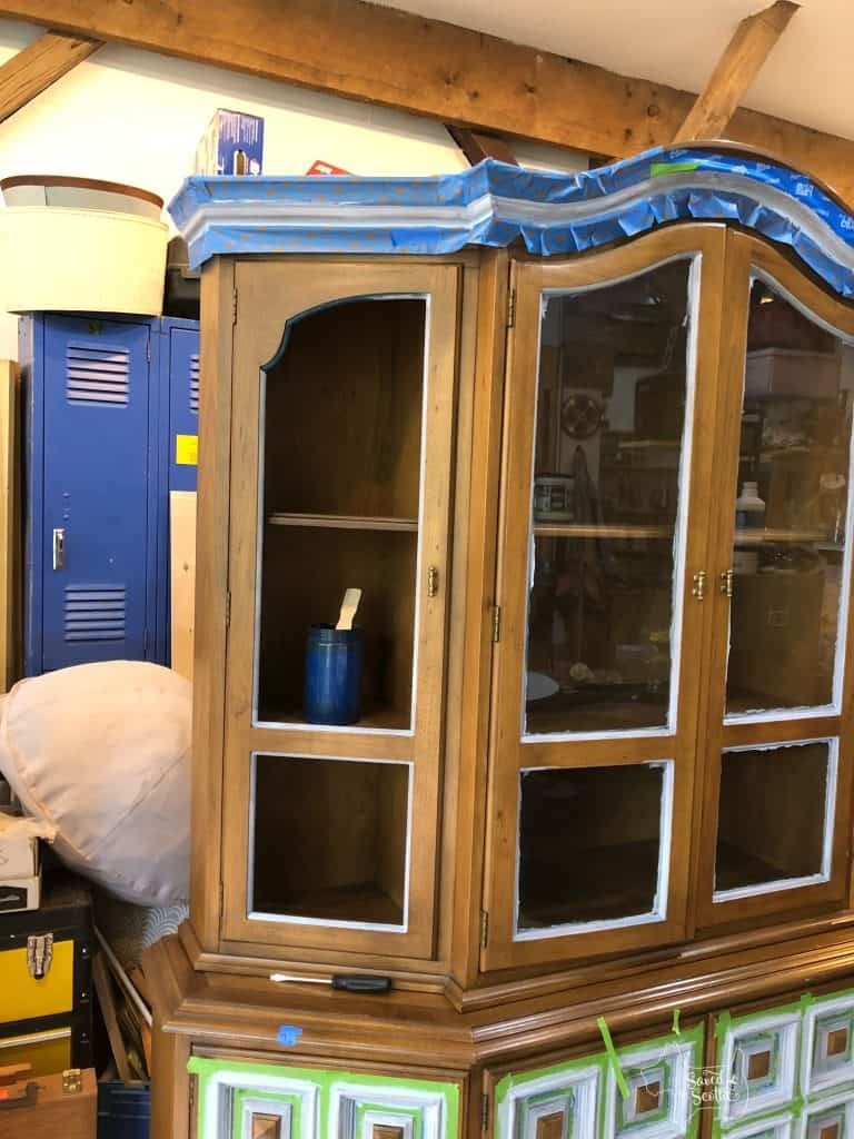 Very top of china cabinet taped off ready for paint. Using Scotch Blue painting tape.