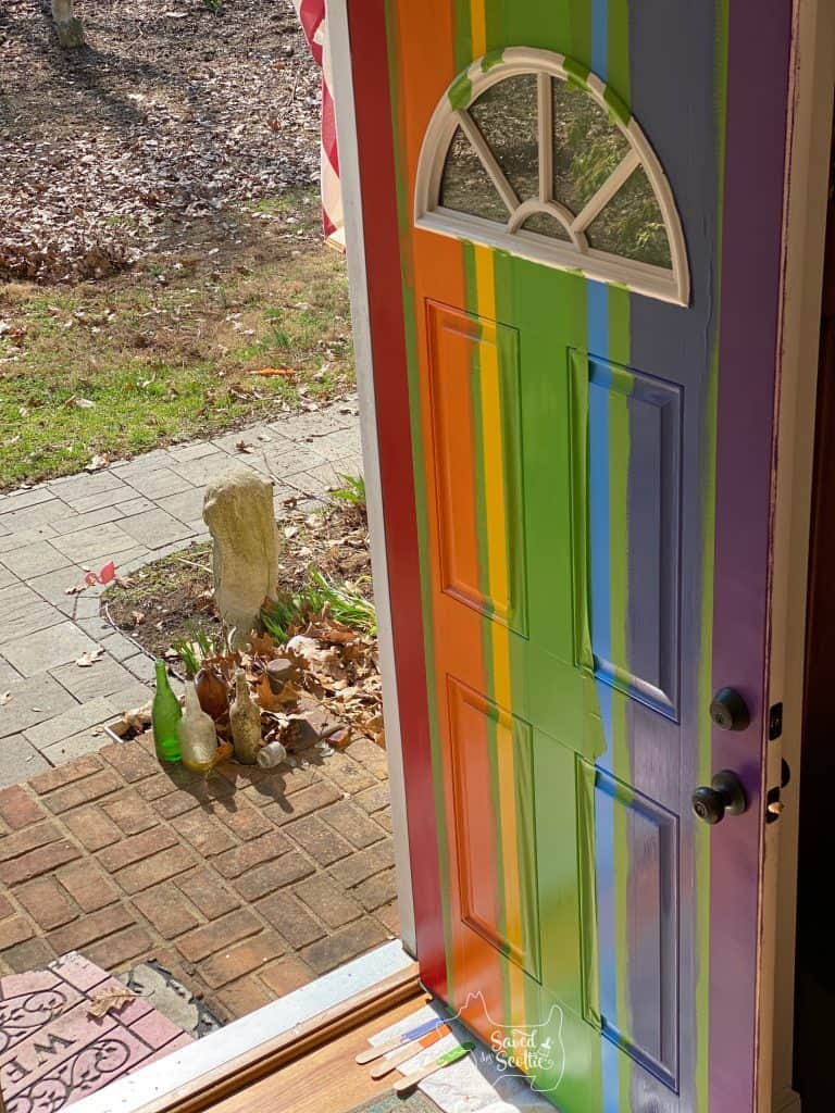 painted door fully filled in with new paint colors with Frog Tape still attached.