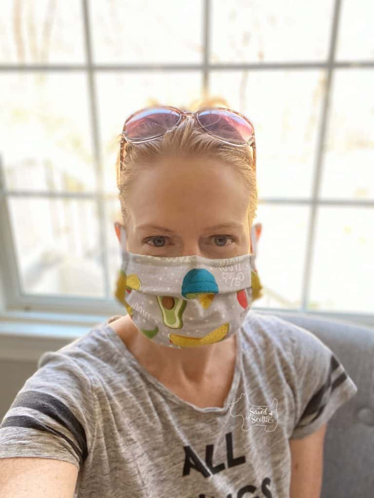 woman wearing DIY mask in front of window