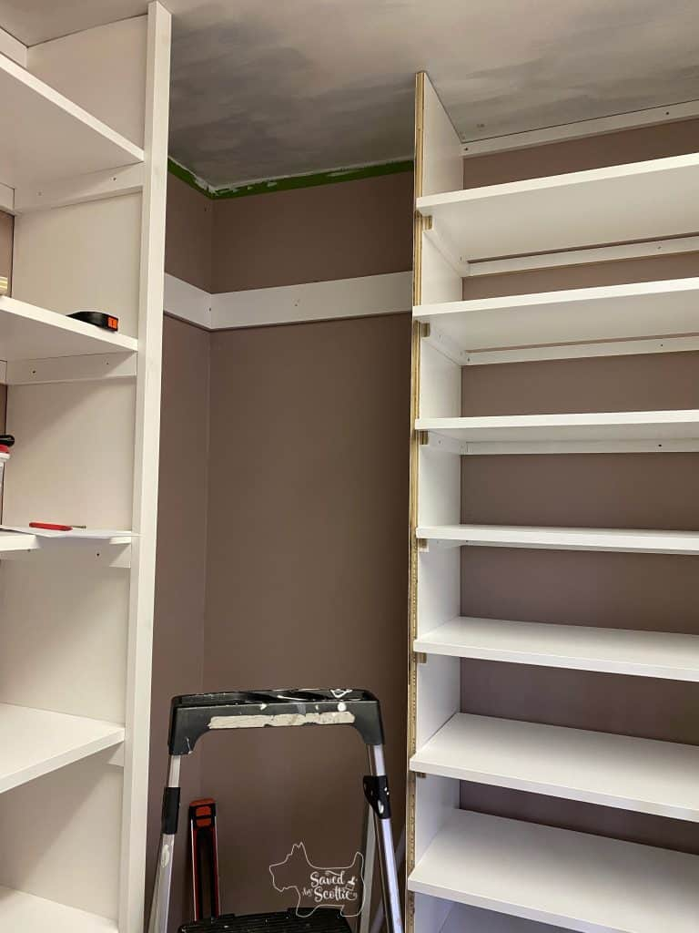 closet makeover shelving units in place with shoe shelves drying