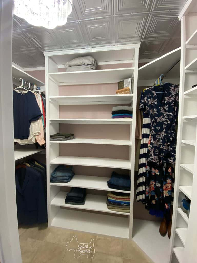 finished closet makeover staged with clothing