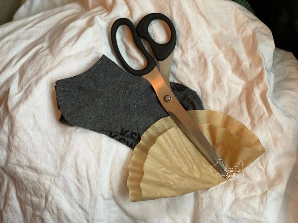 supplies needed for no sew facemask creation. low cut socks, coffee filter, and sharp scissors.