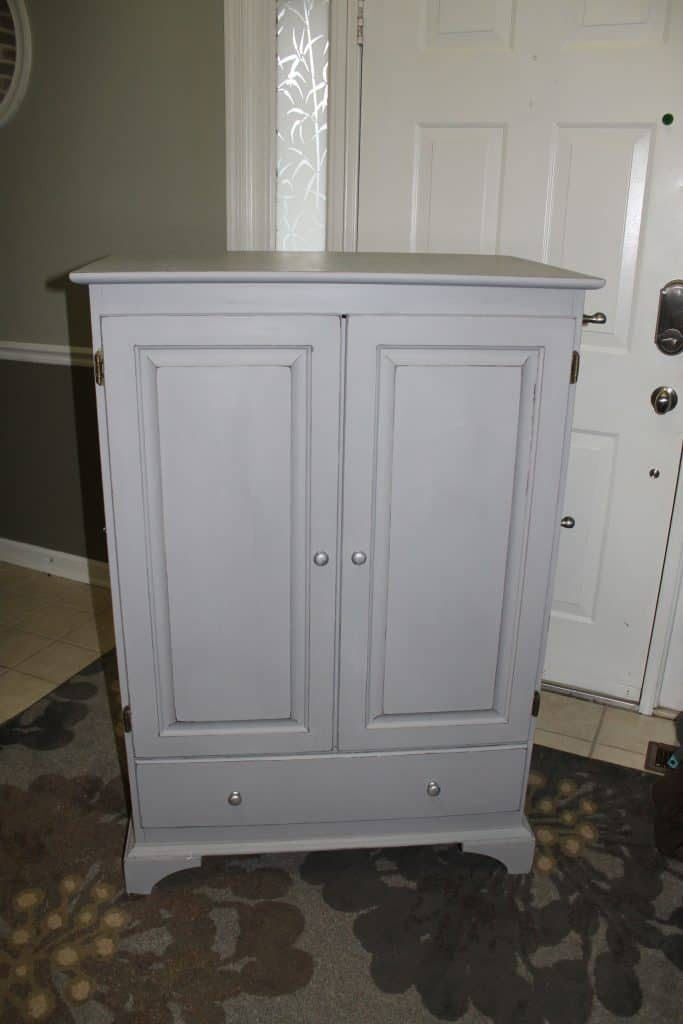 cabinet painted grey with closed doors