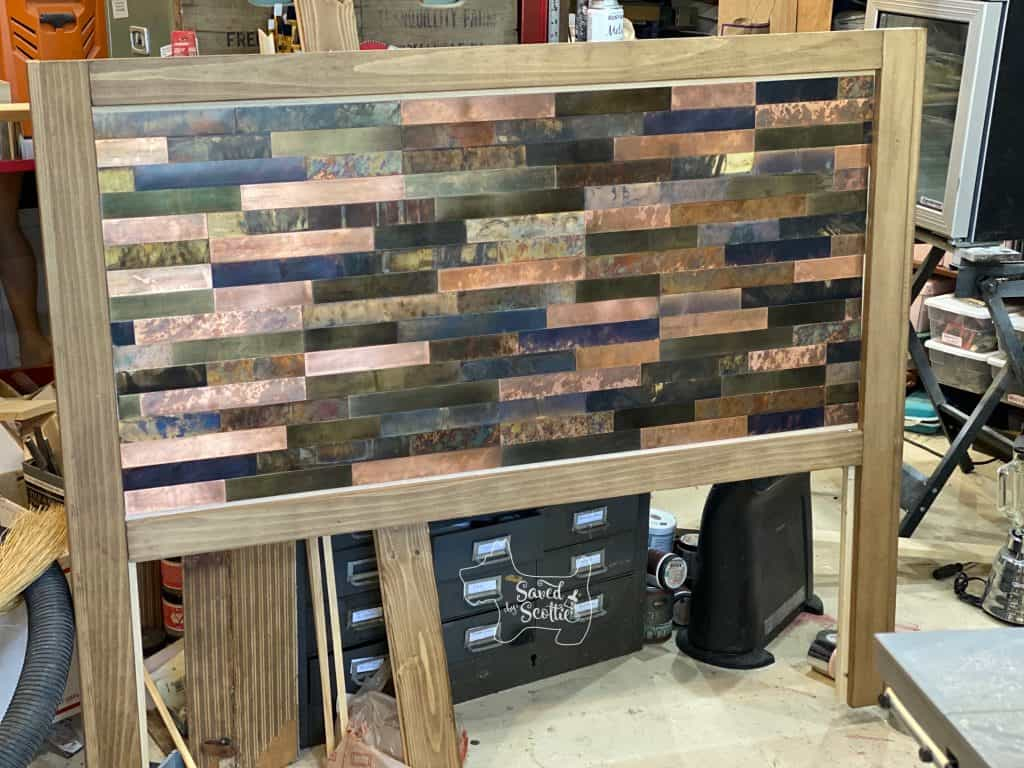 diy headboard ready for trim to hide tile edges.
