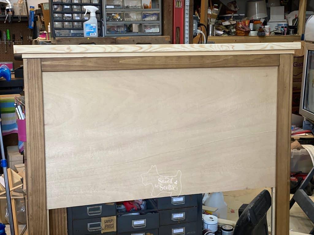 basic headboard frame missing bottom edge and metal tiles.