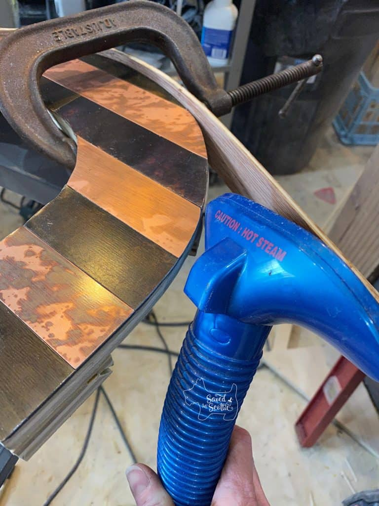 clamp on curve in place on outside edge of letter as steamer is used to show how to bend wood
